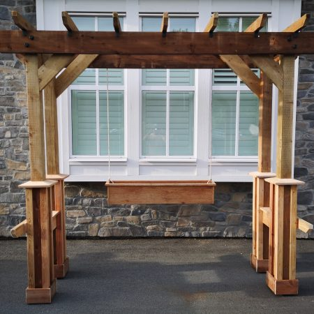 Cedar pergola with hanging planter at the rear